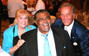 Rosey Grier pictured with Shirley and Pat Boone after Rosey had spoken at the event